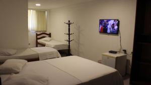 Cama ou camas em um quarto em Hotel Pousada da Praça
