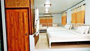 A bed or beds in a room at Oopkaew Resort