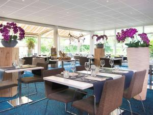 A restaurant or other place to eat at Novotel Maastricht