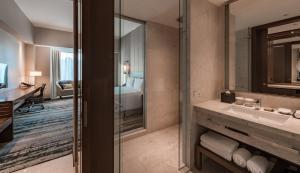 A bathroom at Hilton Kota Kinabalu