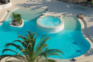 A view of the pool at Hôtel Campo Dell'oro or nearby