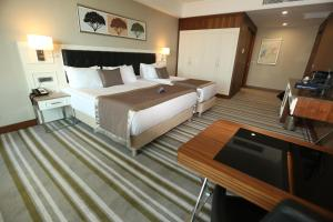 A bed or beds in a room at Radisson Blu Hotel, Diyarbakir