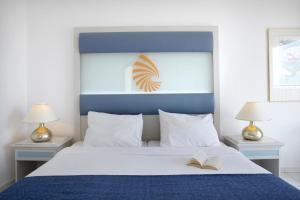A bed or beds in a room at Sunshine Crete Beach