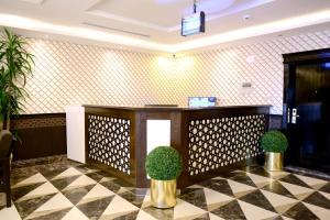 O saguão ou recepção de Marina Hotel