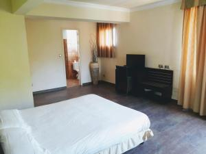 Un ou plusieurs lits dans un hébergement de l'établissement Hôtel Cavalière Surplage
