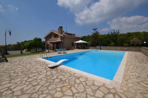 The swimming pool at or near Villa Anna