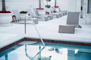 The swimming pool at or near Grand Bohemian Hotel Orlando, Autograph Collection