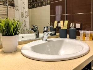 Ванная комната в GUESTHOUSE Апартаменты Премиум