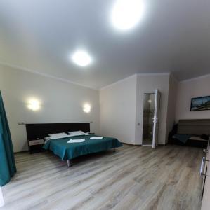 Кровать или кровати в номере Guesthouse Vezer