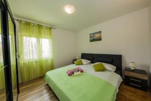 Postel nebo postele na pokoji v ubytování Apartman Adriatic
