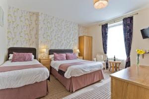 A bed or beds in a room at The Wilton