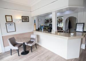 The lounge or bar area at Corner House Hotel Gatwick