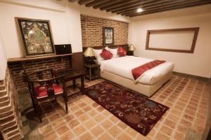 A bed or beds in a room at Heranya Yala