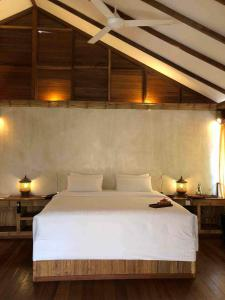 A bed or beds in a room at Japamala Resorts - By Samadhi