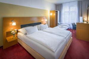 A bed or beds in a room at Theatrino Hotel