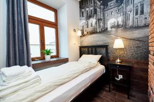 Łóżko lub łóżka w pokoju w obiekcie Carmelito