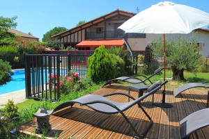 The swimming pool at or near Le Mas des Cerisiers
