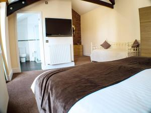 A bed or beds in a room at Mereside
