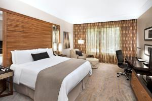 A bed or beds in a room at The Woodlands Resort