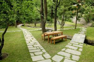 A garden outside Tall Trees Resort by OpenSky
