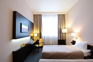Кровать или кровати в номере Отель City Star