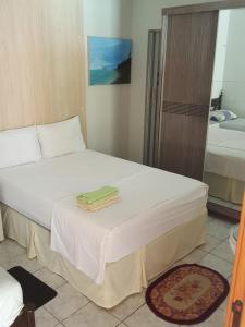 A bed or beds in a room at Dias de Sol & Mar