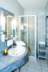 Ein Badezimmer in der Unterkunft Hotel Garni Thermenglück