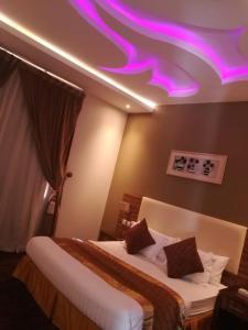 Cama ou camas em um quarto em Taj Al Fakhama