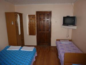 Кровать или кровати в номере Guest House on Zarechnaya 2