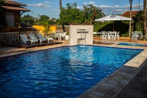 The swimming pool at or near Pousada Shangrila