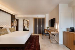 A bed or beds in a room at The Setai Tel Aviv