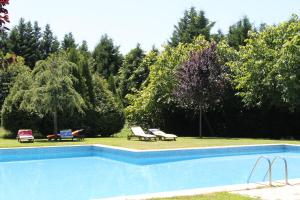 The swimming pool at or near Quinta Vale do Homem