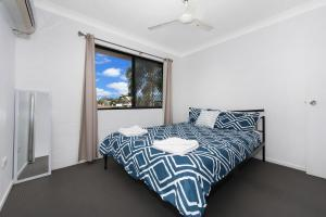 A bed or beds in a room at 3 bedroom home