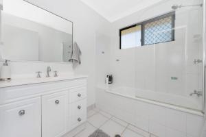 A bathroom at 3 bedroom home