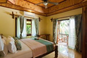 A bed or beds in a room at Anse Severe Beach Villas