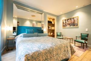 A bed or beds in a room at Bohemian Suites Athens