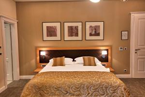 Letto o letti in una camera di Villa Filaus B&B