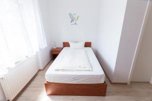 Кровать или кровати в номере Hotel Agat Hofheim-Wallau