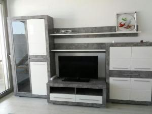 A television and/or entertainment center at Laguna Palace Appartments