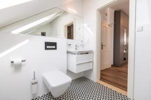 Koupelna v ubytování SLAVIA penzion
