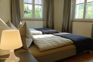 Ein Bett oder Betten in einem Zimmer der Unterkunft Haus zur Rose, St.Gallen, Bodensee, Säntis