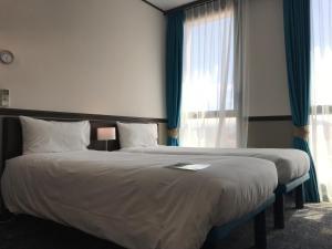 Postel nebo postele na pokoji v ubytování Toyoko INN Marseille Saint Charles
