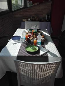 Un restaurante o sitio para comer en Rifugio Nel Bosco