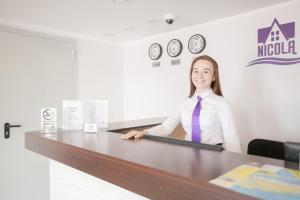 Лобби или стойка регистрации в Отель Никола