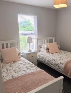 A bed or beds in a room at Grange House