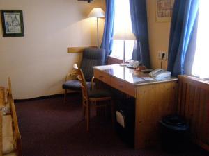 Телевизор и/или развлекательный центр в Hotel Zatkuv dum