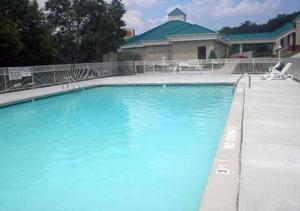 The swimming pool at or near Baymont by Wyndham Harriman