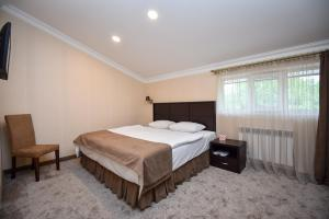 A bed or beds in a room at Laguna Hotel