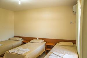 A bed or beds in a room at Candeias Hotel Gold Fish