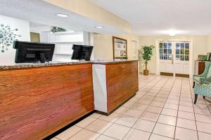 The lobby or reception area at Super 8 by Wyndham Kissimmee